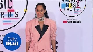 Pretty in pink! Tracee Ellis Ross arrives on AMAs red carpet