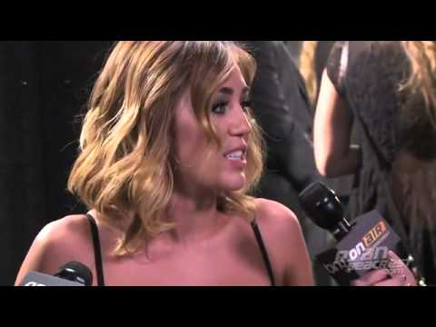 Kendall and Kylie Jenner interview Jennifer Lawrence during The Hunger Games premiere in LA