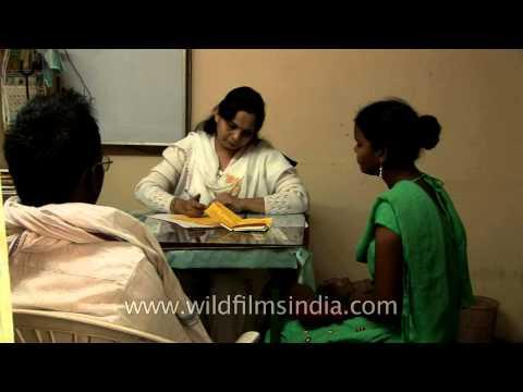 Doctor examines a patient at the Panchgavya Chikitsa Kendra