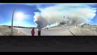 Control this video: Smokey views of Fort McMurray fire (360 Video)