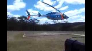 NSW Rural Fire Service helicopter refuelling landing. RFS