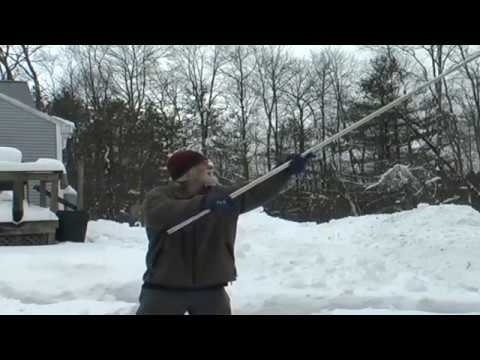cleaning snow from solar panels
