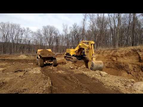 Neri excavating cat 245