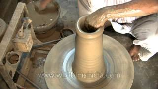 Potter Making An Earthen Flower Pot In India