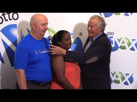 Winners pick up their $55-million Lotto Max prize