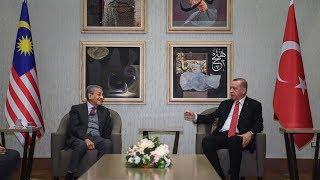 Erdogan surprises media at airport as he welcomes Dr M