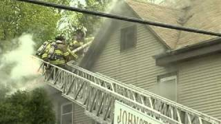 Smoke billows from a home on Plainfield St in Johnston, RI
