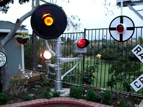 My backyard railroad signal garden – With the lights on.