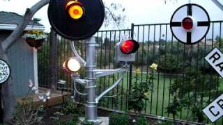 My backyard railroad signal garden - With the lights on.