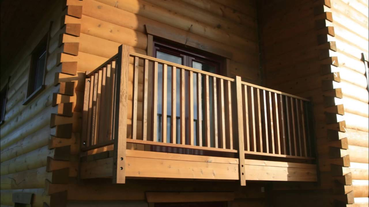 House Wooden Balcony With White Railings
