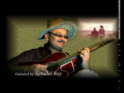 "Satadal Ray humbly tries to play  "" Neele Neele Ambar Par "" from the film ' Kalakaar '"
