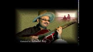 "Satadal Ray humbly tries to play  "" Neele Neele Ambar Par "" from the film"