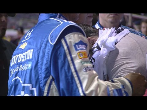 Jimmie Johnson helped from car after race