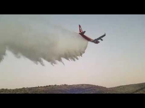 Supertanker fights fires in Israel