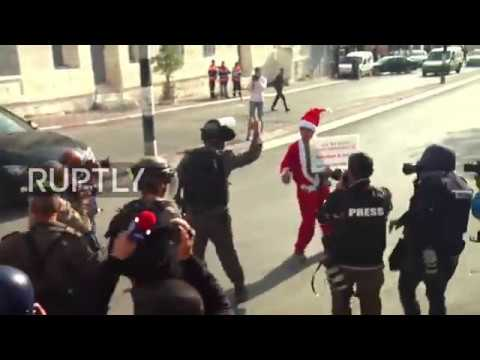 State of Palestine: Santa-costumed protesters clash with Israeli forces