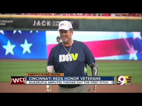 Quadruple amputee veteran throws first pitch at Reds military appreciation day