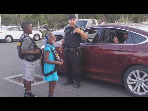 Thumbnail: 9-Year-Old Girl Who Cried About Police Shootings Gets To 'Arrest' Officers