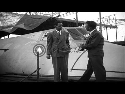 American aviator Howard Hughes and an official speak to newsmen in the United Sta...HD Stock Footage