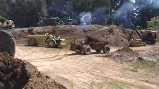 3 Euclid articulated off-road dump trucks work the pit with a B61 Mack...