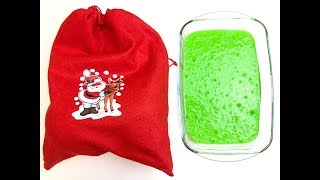 Making X'mas Grinch slime with Santa's bag and funny balloons
