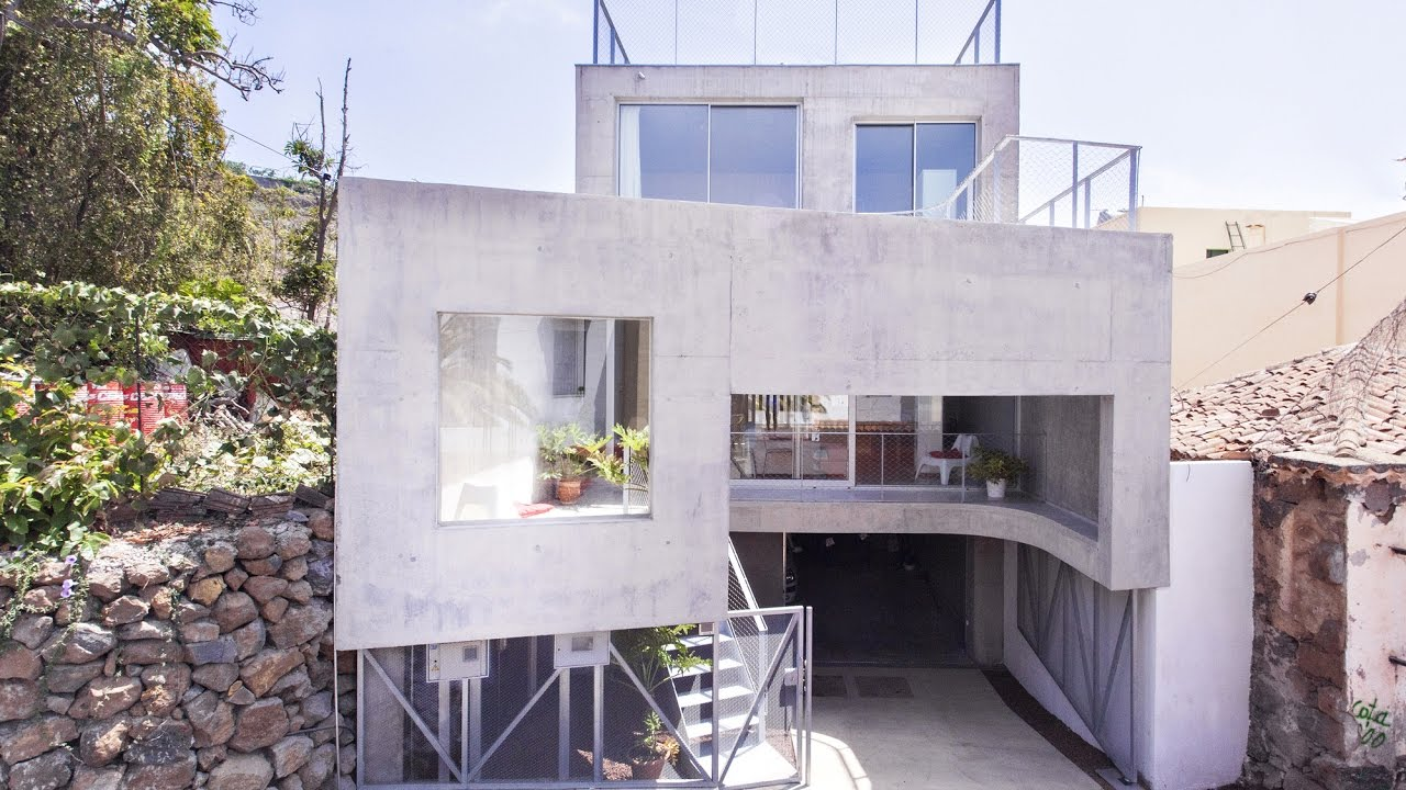 Three story concrete house on sloping lot idea youtube for Building a house on a sloped lot