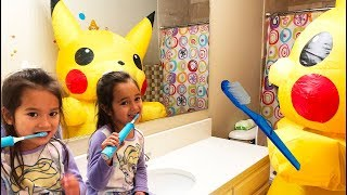 The twins brush their teeth with Pikachu