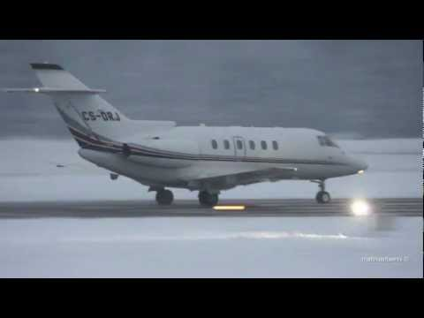 Snowy take off Raytheon Hawker 800XP at Airport Bern-Belp
