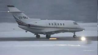 Snowy take off Raytheon Hawker 800XP at Airport Bern-Belp