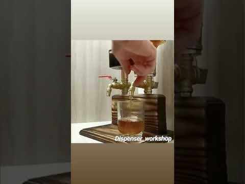 Liquor dispenser. Whisky dispenser. Woodworking.