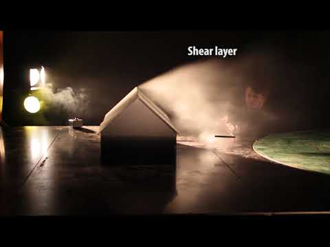 Flow visualization around simple building shapes in wind tunnel