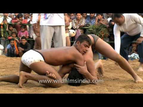 Rural mud wrestling has made it into the big city of Delhi
