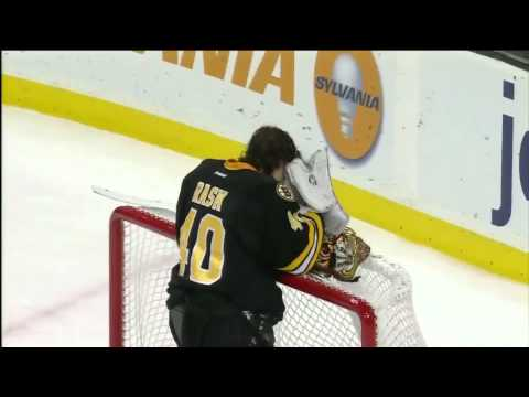Tuukka Rask stops puck with mask 1/21/12