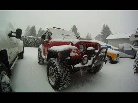 Jeep Wrangler playing in the snow around town