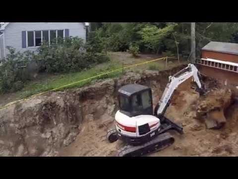Bobcat E45 Digging Up Big Stump