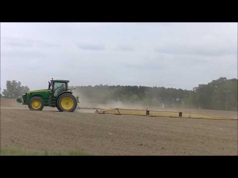 JOHN DEERE 8295R PULLING A LAND PLANE. GARGUILO FARMS LAND PLANING