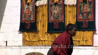 Rituals being performed during the unfurling of Thangka in Bhutan
