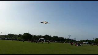Airplane putting on a show at Orange Walk Football Game