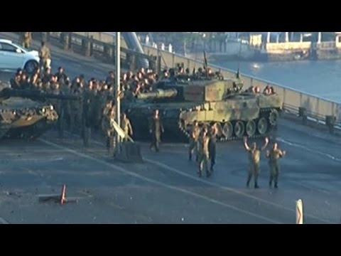 Turkish soldiers walk with hands up