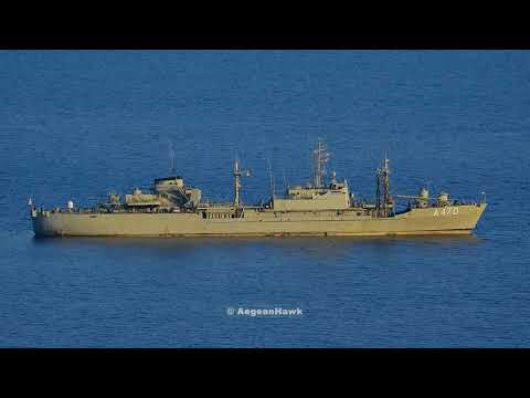 Hellenic Navy General Support Ship A470 HS Aliakmon lowering the Flag just before sunset.