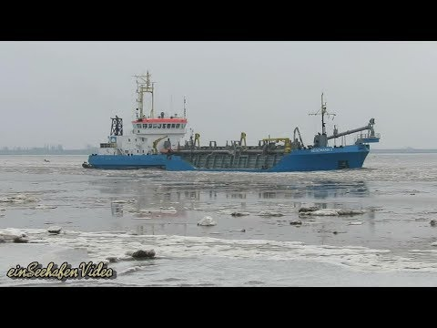 suction hopper dredger HEGEMANN 1 DQKQ IMO 9113070 on ice Emden Baggerschiff im Treibeis