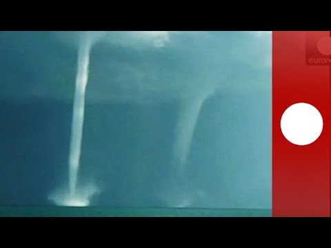 Waterspouts tower over China Qinghai Lake