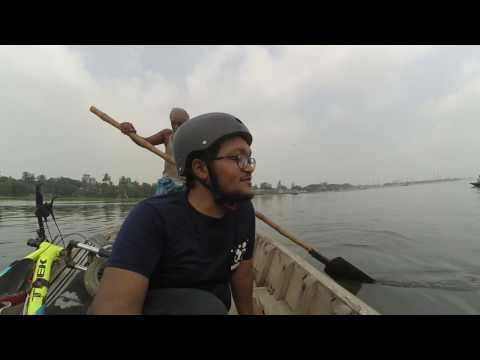 Crossing Buri-ganga river by boat