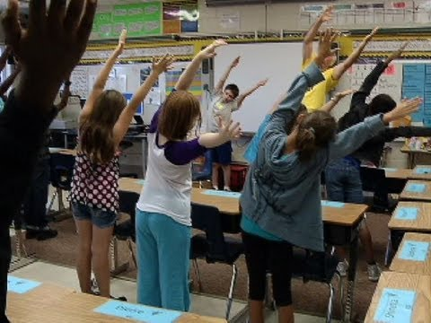 Just breathe. Students practice yoga in classrooms