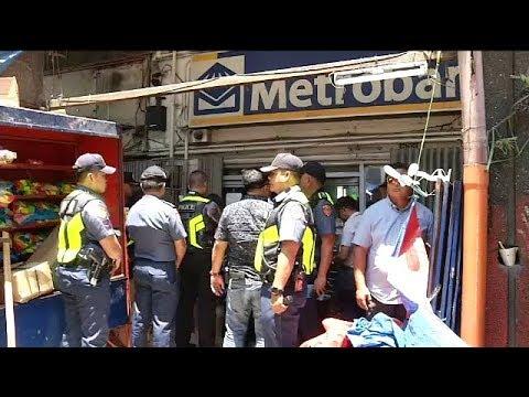 Manila mayor, police raise doubts as they hunt Binondo bank robbers