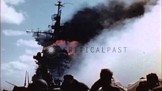 American aircraft carrier burning from Japanese Kamikaze strike, during World War...HD Stock Footage