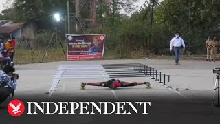 Teenager breaks world record for quickest 'limbo skate'