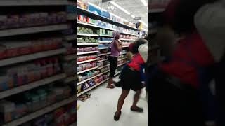 WorldStar Ghetto hood cat fight in the hair products aisle at Walmart