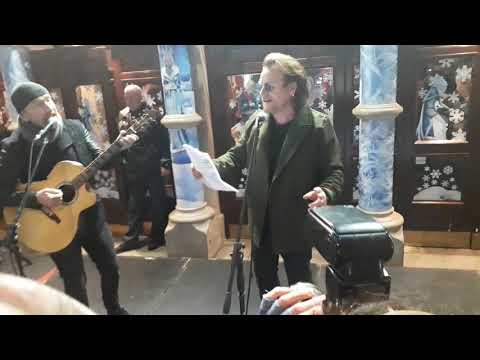 Watch U2's Bono and the Edge busk for the homeless in Dublin on Christmas Eve