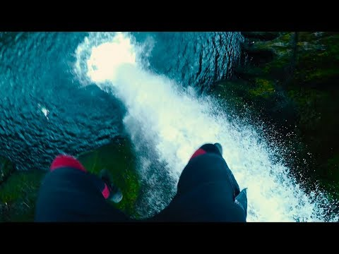 MASSIVE CLIFF JUMP OFF REMOTE WATERFALL   FIRST  DESCENT (4K)