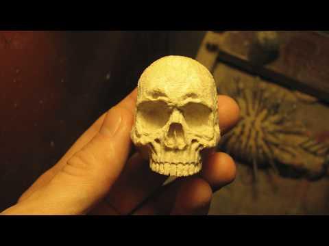 Wooden skull. Pipe tamper. Hand carving.